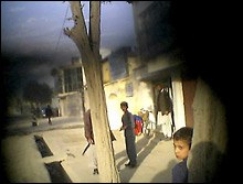 UNIQUE PEEK: A cell phone camera hidden under a burqa gives a unique view of the streets of Kabul. SARA TERRY