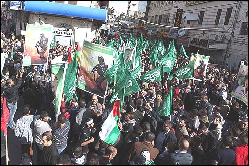 PA Arabs waving Hamas flags during a demonstration in Ramallah.Photo Credit: Issam Rimawi/Flash90