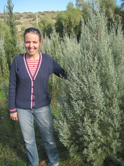 Francheska Goodenough stands next to her chosen tree. Yoav Devir