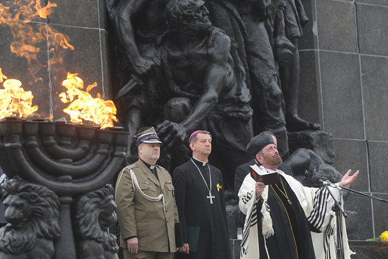 Cantor Joseph Malovany, right, sings during prayers in front of the Warsaw Ghetto Uprising memorial in Warsaw, April 19, 2013.