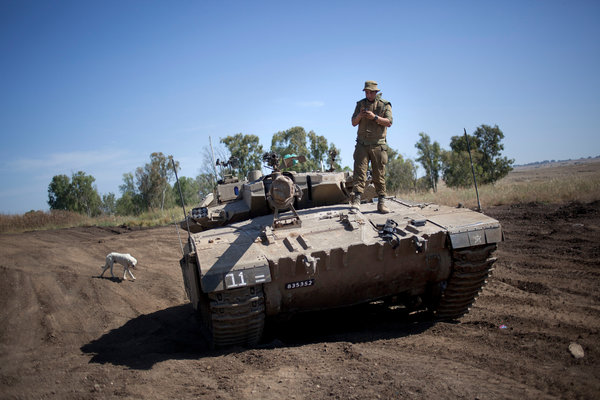 An Israeli soldier at a training ground in Israel's Golan Heights, near the increasingly volatile border with Syria.