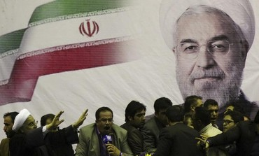 Then-candidate for Iranian president Hassan Rohani (L) waves to supporters Photo: REUTERS
