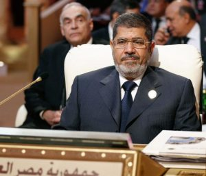 KARIM SAHIB/AFP/GETTY IMAGES Egyptian President Mohammed Morsi attends a summit in Doha, Qatar in March.