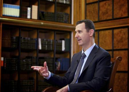 Syria's President Bashar al-Assad speaks during an interview with Russian state television RU24 in Damascus in this September 12, 2013 handout photo by Syria's national news agency SANA. Credit: Reuters/SANA/Handout via Reuters