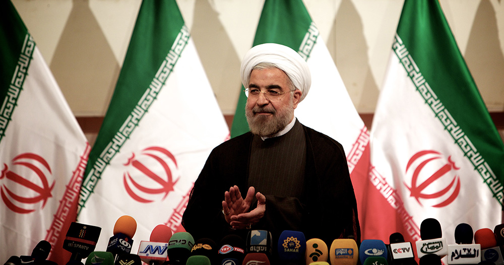 Iranian President Hassan Rouhani claps during a press conference in Tehran. (Behrouz Mehri/AFP/Getty Images)