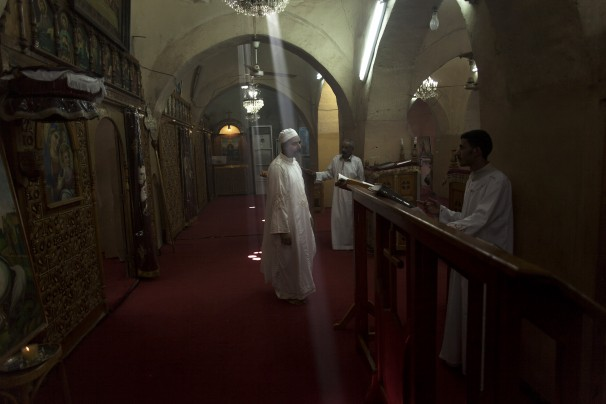 (Manu Brabo/ Associated Press ) - In this Wednesday, Nov. 13, 2013 photo, Coptic monks and altar boys worship in Mar Girgis, or St. George, Monastery, south of the ancient city of Luxor, Egypt. The week-long festival of Mar Girgis, has been held in Luxor annually for more than a century, attracting as many as 2 million pilgrims from across Egypt to one of the biggest and most exuberant events of the year for Orthodox Coptic Christians. This year, however, the government canceled the festival, fearing it would be a target for Islamic militants.