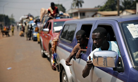 A convoy of more than 100 vehicles carrying Muslims trying to flee Bangui. Photograph: Jerome Delay/AP