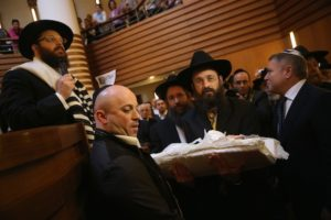 An infant being carried before his circumcision at an Orthodox synagogue in Berlin in 2013. (Sean Gallup / Getty Images)