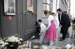 A family lights candles at the Jewish Museum, site of a shooting in central Brussels, Belgium. /  Eric Vidal, REUTERS