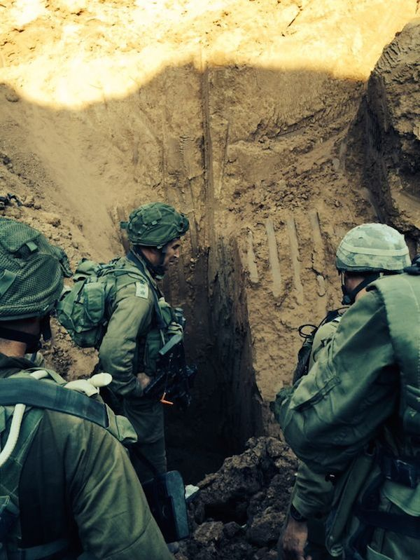 During Operation Protective Edge, Israeli soldiers seen at the entrance to a Hamas terror tunnel found near the Erez border crossing into the Gaza Strip. Credit: IDF Spokesperson/Flash90.