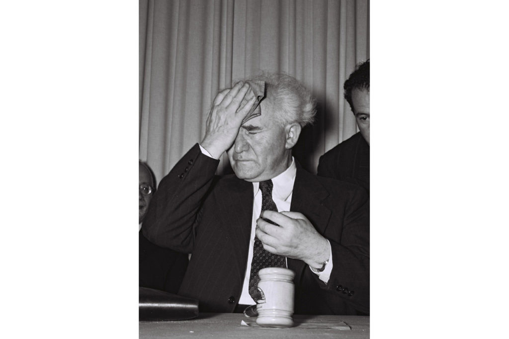 Israel's first prime minister, David Ben Gurion, mops his forehead just before he stands up to read out Israel's Declaration of Independence in Tel Aviv, on May 14, 1948. Ben Gurion, a Polish immigrant, was Israel's founding father, leading the Jewish state through the 1948-49 War of Independence and the 1956 Suez War.