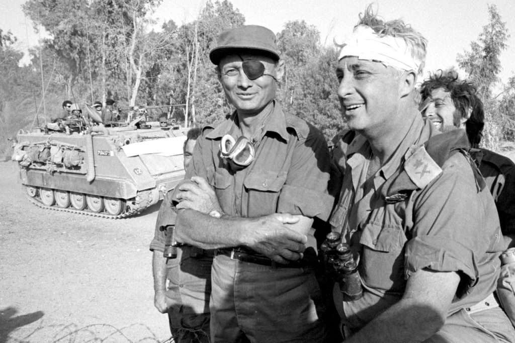 In October 1973, future Israeli Prime Minister Ariel Sharon helped turn the tide of the fourth Arab-Israeli war after a surprise attack by Egypt and Syria, eventually encircling the Egyptian Third Army. Mr. Sharon (right), recovering from a head injury, stands with Israeli Defense Minister Moshe Dayan on the western side of the Suez Canal.