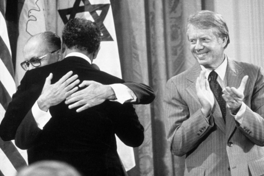 As President Jimmy Carter applauds, Israeli Prime Minister Menachem Begin and Egyptian President Anwar al-Sadat embrace in the East Room of the White House after the signing of a 'Framework for Peace' in the Middle East, on Sept. 17, 1978. Mr. Sadat's visit to Jerusalem in 1977 led to the U.S.-brokered Camp David accords in 1978, followed by Israel's first peace treaty with an Arab state the following year.