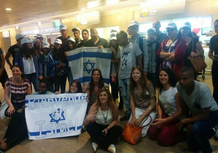 International high school students arrive at Ben Gurion Airport on Monday and are greeted by Dr. Benny Fisher, head of the Education Ministry's Administration for Rural Education and Youth Immigration. (photo credit:Courtesy)