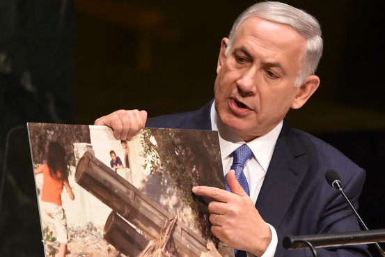 Israeli Prime Minister Benjamin Netanyahu holds up a photo said to be of a Hamas rocket as he addresses the 69th session of the United Nations General Assembly on Monday. Agence France-Presse/Getty Images