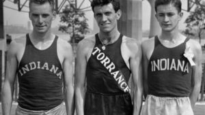 FILE -- In a July 13, 1936 file photo, Don Lash of Indiana, left, Louis Zamperini of Los Angeles, center, and Thomas Deckard of Indiana, who will represent the United States in the Olympic Games in the 5,000 meter team, at the Olympic tryouts in New York. Zamperini, a U.S. Olympic distance runner and World War II veteran who survived 47 days on a raft in the Pacific after his bomber crashed, then endured two years in Japanese prison camps, died Wednesday, July 2, 2014, according to Universal Pictures studio spokesman Michael Moses. He was 97. (AP Photo, File)