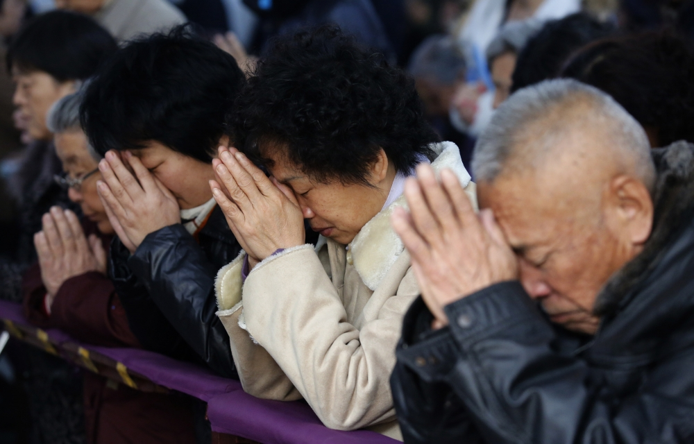 Believers take part in a weekend mass at an underground Catholic church in Tianjin. (PHOTO: REUTERS/KIM KYUNG-HOON)