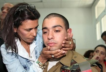 Sgt. Elor Azariya is hugged by his mother