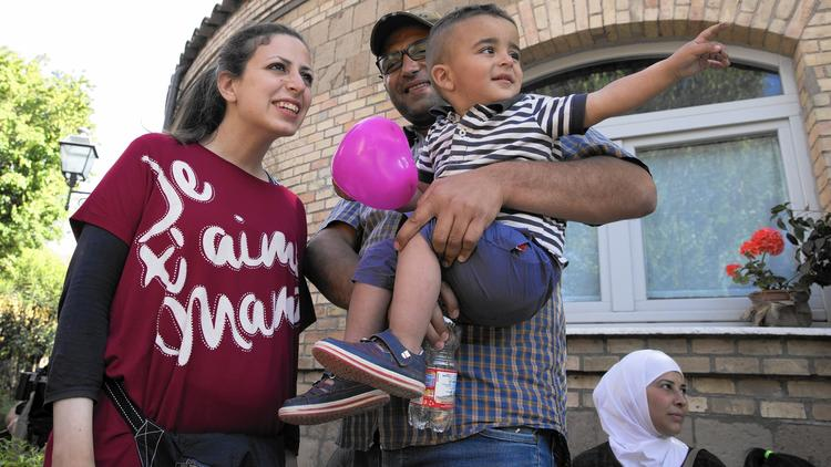 Refugees Nour Essa, husband Hasan Zaheda and son Riad are among the 12 Syrians plucked from a Greek camp by Pope Francis and placed with the charity Sant'Egidio in Rome's Trastevere neighborhood. (Alessandra Tarantino / Associated Press)