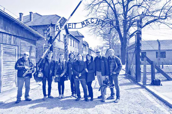 ZLM crew standing in front of death camp gate