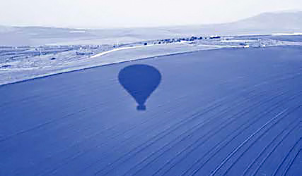 View from hot air balloon with balloon shadow
