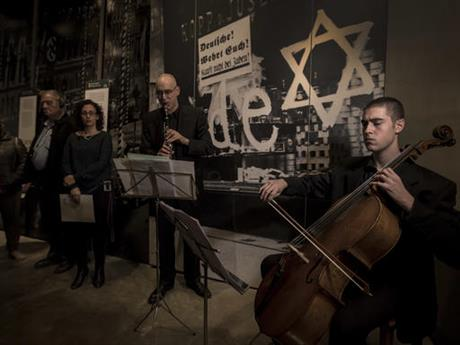 In this Monday, Nov. 21, 2016 photo, Israeli musicians perform at Yad Vashem Holocaust Memorial in Jerusalem. For the first time in Yad Vashem's 63-year history, live music echoed through the halls of Israel's national Holocaust memorial in a somber tribute to the works of musicians who created a vibrant cultural life in the Terezin concentration camp before being sent to their deaths. (AP Photo/Tsafrir Abayov)