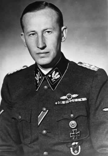"FILE - The 1942 file photo shows Nazi leader Reinhard Heydrich in an unknown location sometime in 1942.  Lina Heydrich, the widow of assassinated Heydrich, one of the main architects of the Holocaust, was among the most prominent recipients of pensions for ""victims of war"" who were injured in World War II.  (AP Photo)"