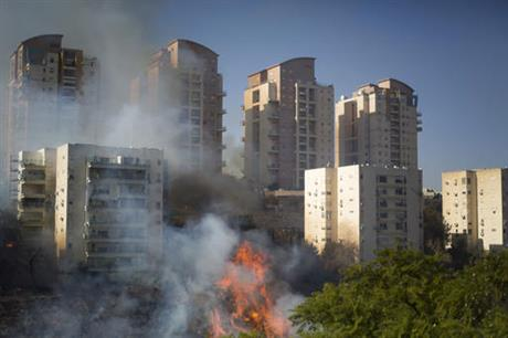 A fire burns in Haifa, Israel, Thursday, Nov. 24, 2016. Israeli police have arrested four Palestinians in connection with one of several large fires that damaged homes and prompted the evacuation of thousands of people in the past few days. Police are investigating the causes, including possible arson. Windy and hot weather have helped fan the flames. The blazes started three days ago near Jerusalem and in the north. Hundreds of homes were damaged. Russia, Italy and other countries are assisting the Israeli firefighters.(AP Photo/Ariel Schalit)